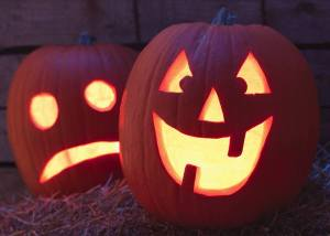 Two Pumpkins carved into Jack-o-Lanterns for Halloween