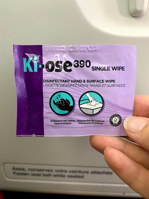 disinfectant wipe on an airplane provided while traveling in a pandemic