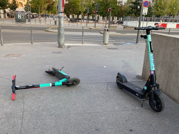 scooters on the ground in lyon france