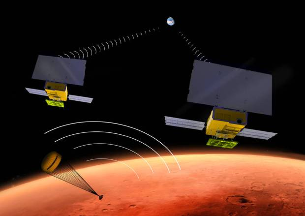 Artist's conception of the MarCO CubeSats flying past Mars as the InSight lander descends to the surface. Image Credit: NASA/JPL-Caltech