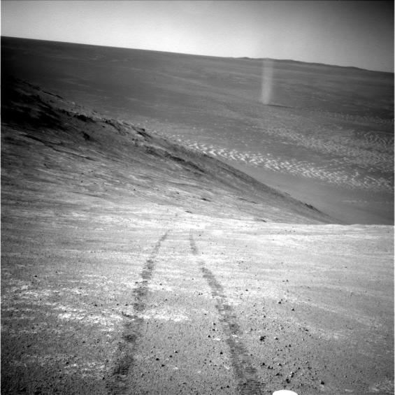 Dust devil seen by Opportunity on sol 4332 inside Endeavour crater. While not many dust devils have been seen by Opportunity, many had been imaged by its twin rover Spirit, in Gusev crater. Photo Credit: NASA/JPL-Caltech