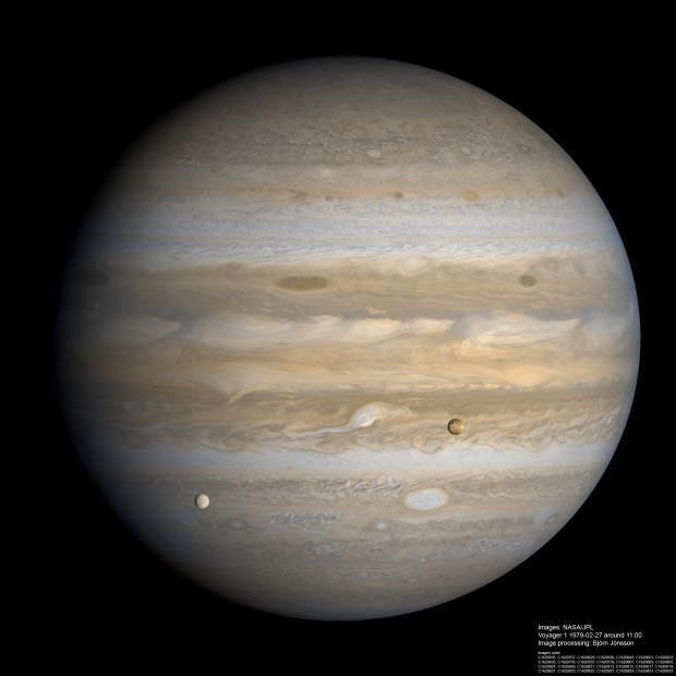 Europa (left) and Io (right) pass in front of Jupiter in this Voyager 1 image from 1979. Credit: NASA / JPL-Caltech