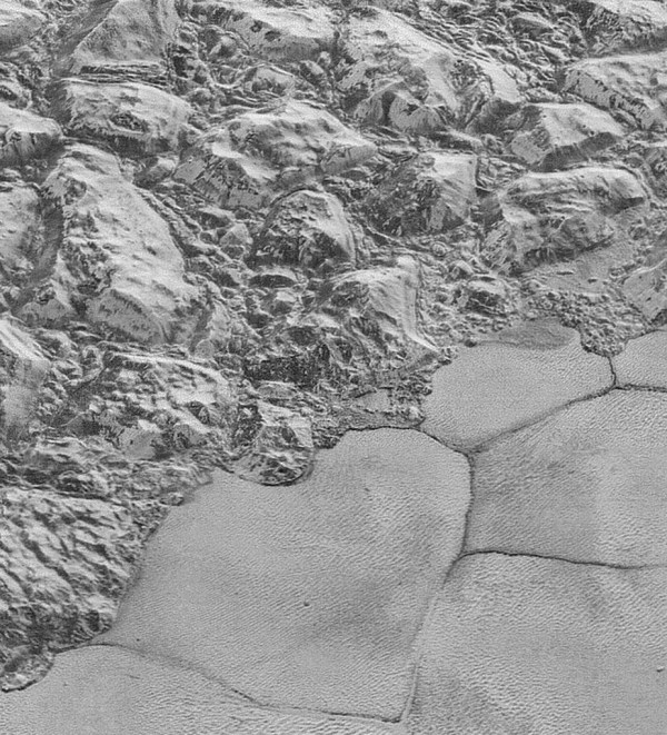 Closer view of the rugged mountainous highlands of water ice adjacent to the edge of the Sputnik Planum plains and glaciers of nitrogen ice. Photo Credit: NASA/JHUAPL/SwRI