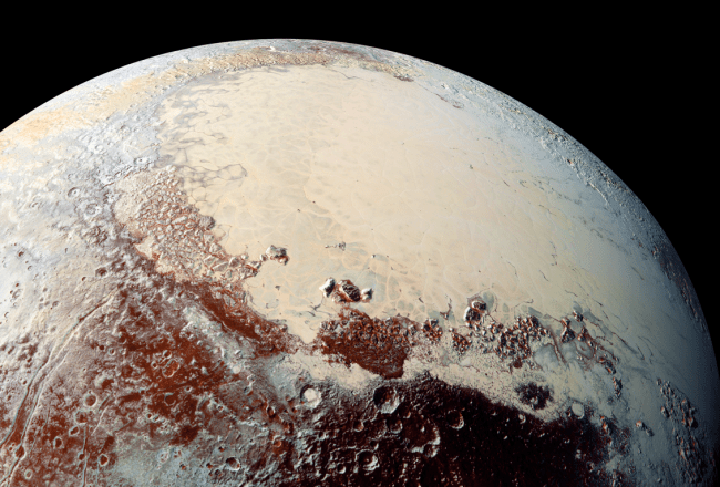 View of Sputnik Planitia on Pluto. This vast region of nitrogen ice provides clues that a subsurface ocean of liquid water exists on Pluto. Photo Credit: NASA/JHUAPL/SwRI