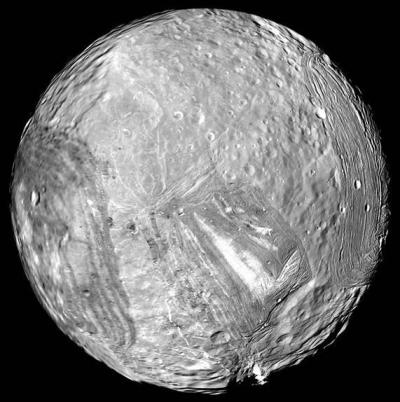 Uranus' moon Miranda shows signs of past geological activity, with deep canyons and other chaotic terrain. Photo Credit: NASA/JPL-Caltech