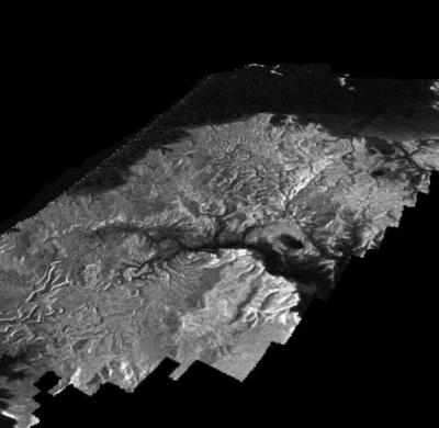 A perspective radar view of the eastern shoreline of Kraken Mare, another large hydrocarbon sea on Titan. The image has been despeckled to bring out more detail in the surface features. Image Credit: Credit: NASA/JPL-Caltech/ASI