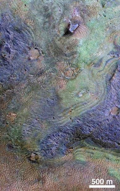 Orbital view of Nili Fossae, where the largest known deposit of carbonates is located (green areas). Image Credit: NASA/JPL-Caltech/JHUAPL/Univ. of Arizona