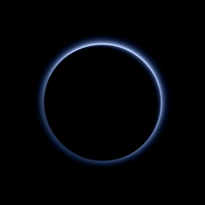"The ""blue skies of Pluto"" as seen by New Horizons after closest approach, one of the most iconic images of the mission. Soot-like particles in the atmosphere scatter sunlight in a way that the atmosphere appears blue, similar to what happens on Earth. Image Credit: NASA/JHUAPL/SwRI"