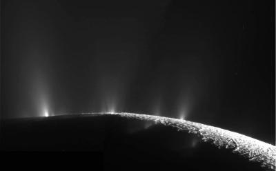 The geysers of Enceladus, erupting from cracks in the icy crust at the south pole. Photo Credit: NASA/JPL-Caltech