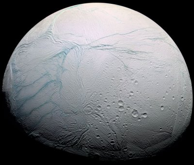 View of Enceladus from Cassini. The tiger stripe fissures are prominently seen on the left side (actually the south pole). Photo Credit: Cassini Imaging Team/SSI/JPL/ESA/NASA