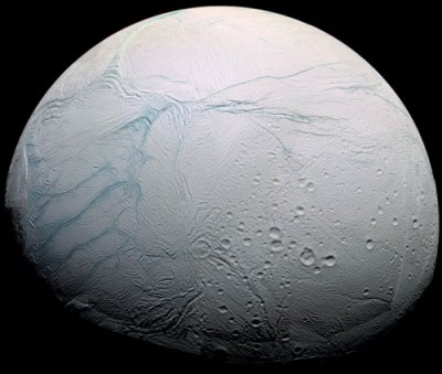 Saturn's moon Enceladus has a global ocean of water beneath its surface, similar to Europa. The Tiger Stripe fissures, which the plumes erupt from, are visible on the left (actually the south pole). Image Credit: NASA/JPL-Caltech