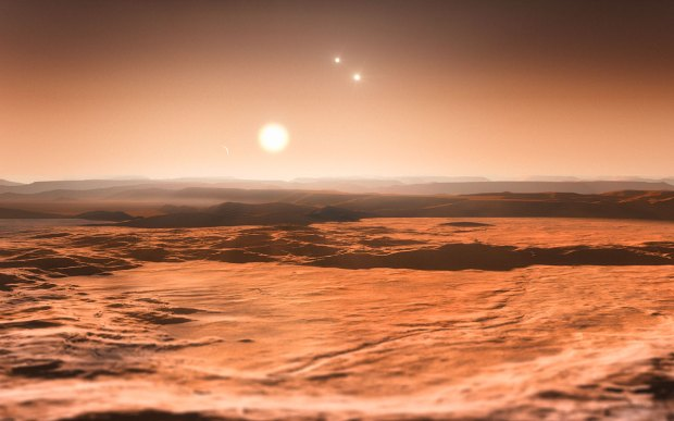 Artist's conception of the view from one of three super-Earth planets orbiting the star Gliese 667C, showing all three stars of the Gliese 667 system.