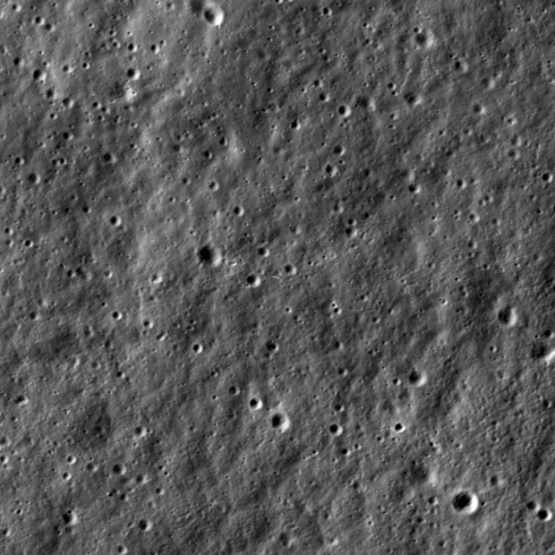 Image taken by the Lunar Reconnaissance Orbiter (LRO) on Jan. 14, 2014, showing LADEE as it orbited above the Moon's surface (small object near center of image). LADEE was orbiting about 5.6 miles (9 kilometers) below LRO at the time. Photo Credit: NASA/Goddard/Arizona State University