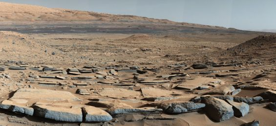 Sedimentary strata at the base of Mount Sharp as seen at the Kimberly location. The strata in the foreground dip toward Mount Sharp, providing evidence of the former lake-filled depression that used to exist before most of the mountain formed. Image Credit: NASA/JPL-Caltech/MSSS