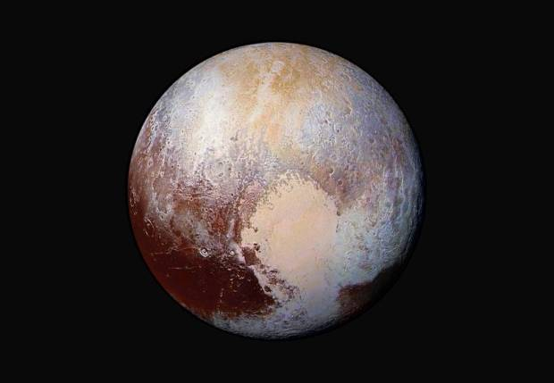 Pluto in enhanced colour. Image Credits: NASA/JHUAPL/SwRI