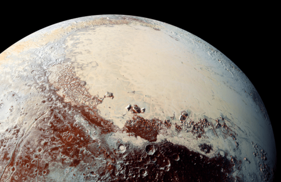 """Sputnik Planum, a large """"sea"""" of nitrogen ice, has icebergs of water ice embedded in its soft surface. Mountains of rock-hard water ice border this frozen sea. Photo Credit: NASA/JHUAPL/SwRI"""