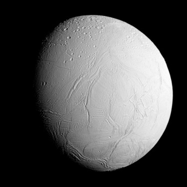 Enceladus as seen from a distance of 60,000 miles (96,000 kilometers) during the flyby. The northern hemisphere is heavily cratered, while the southern hemisphere is wrinkled and cracked, but relatively crater-free. Image Credit: NASA/JPL-Caltech/Space Science Institute