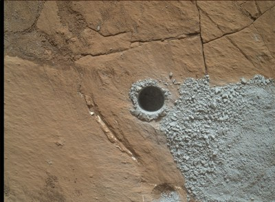The drill hole in the Buckskin rock target. Analysis by the rover shows high levels of silica and hydrogen in these and nearby rocks. Image Credit: NASA/JPL-Caltech/MSSS