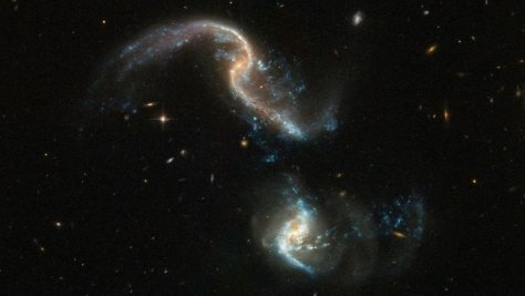Tidal interaction between two galaxies, seen by the Hubble Space Telescope.