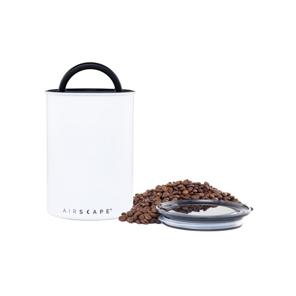 Photo of medium, matte white, stainless steel Airscape kitchen cannister with pile of beans and lid to the right