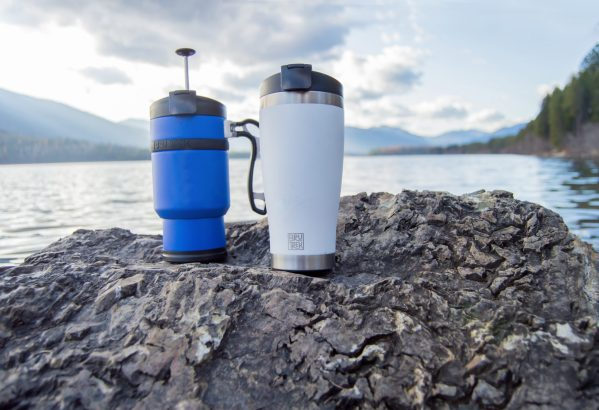 double shot press and adventure tumbler in front of lake