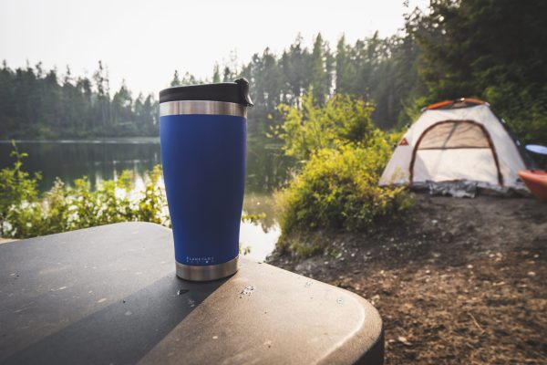 blue adventure tumbler with tent in background