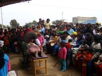 adjusting in Peru crowd of hundreds
