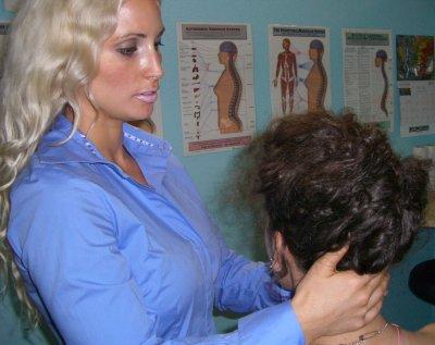chiropractic photo checking neck