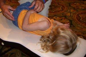 Child on Chiropractors Adjusting Table