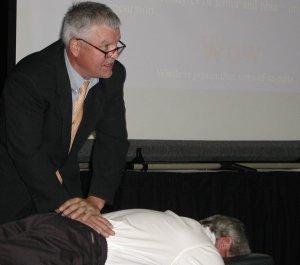 chiropractor Fred Schofield demonstrating sacral spine analysis