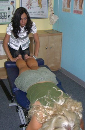 female chiropractor adjustment