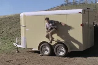man gets slammed into horse trailer