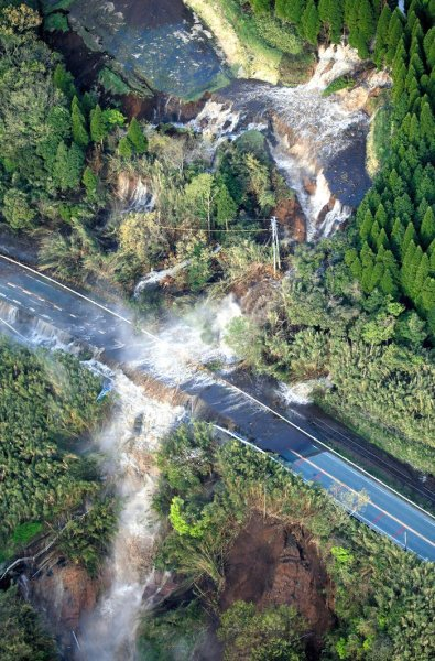 Water flows at a landslide site in Minamiaso Photograph: The Asahi Shimbun/Getty Images