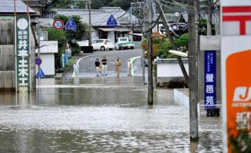 Roads are flooded due to heavy rains caused by Typhoon Malakas in Nobeoka, Miyazaki Prefecture, southwestern Japan, in this photo taken by Kyodo September 20, 2016. Credit Kyodo/via REUTERS