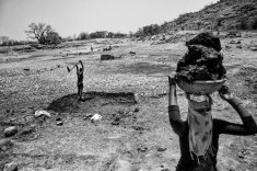 Vivek Singh for the WorldPost In the sweltering heat in Bundelkhand, a region in central India, a man and his wife remove silt from the bottom of a dried-out pond.