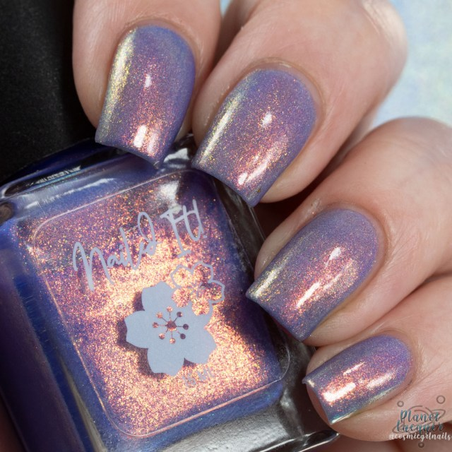 Pictured is a swatch of four fingers painted by Britta in the nail polish Sakura apart of the four piece Secret Garden Collection by Nailed It! Nail Polish.