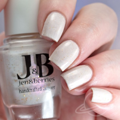 A four finger nail swatch of I'm Sorry I'm Not A Condom - a pale neutral pink crelly with subtle holographic gold glitters and pink to gold shifting shimmer. nail polish by Jen & Berries