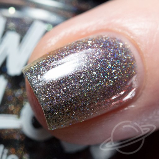 One finger nail macro swatch of Dangersome - a purple/black/red multichrome packed with holographic pigment and holo flakes nail polish by Swamp Gloss polish