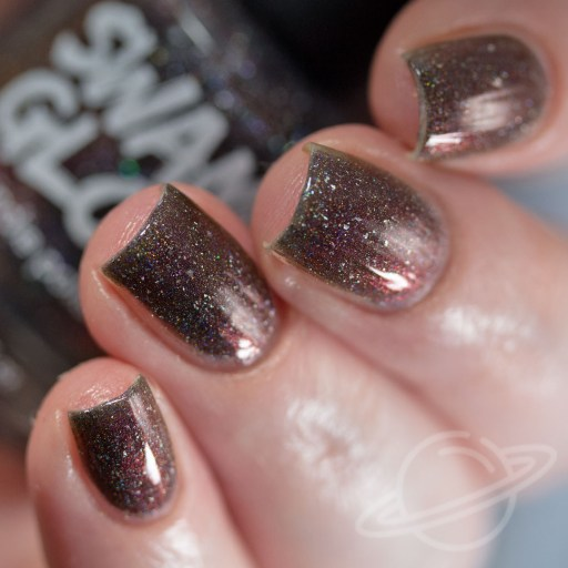 Four finger nail swatch of Dangersome - a purple/black/red multichrome packed with holographic pigment and holo flakes nail polish by Swamp Gloss polish