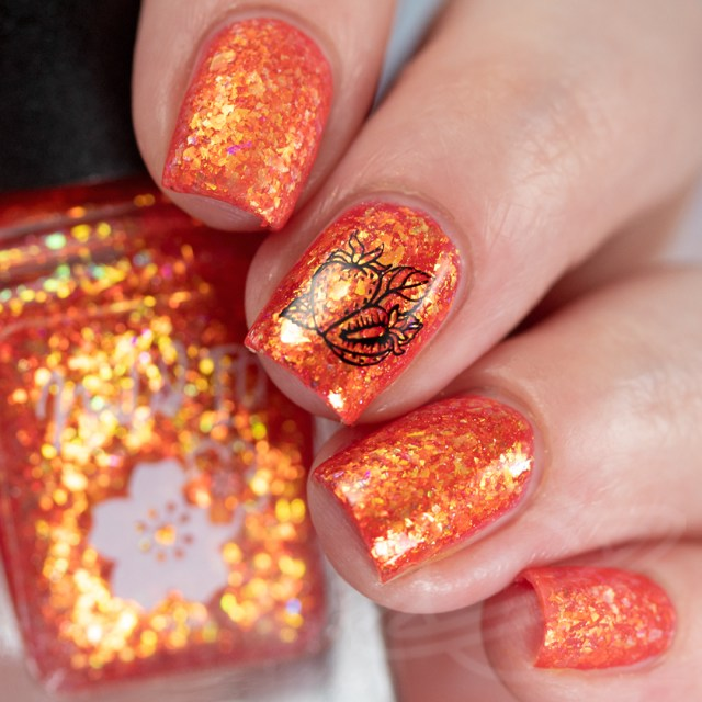This image features a four finger swatch with the nail polish Strawberried Treasure a strawberry jelly base packed with gold/copper/green crystal flakies and a touch of holo from Nailed It! Nail Polish new collection