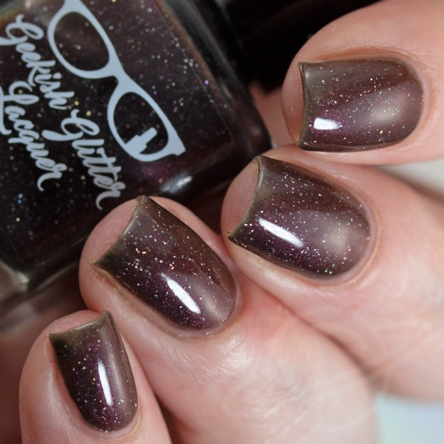 Pictured here is a nail polish swatch which is part of The Very Supernatural Collab. The polish pictured here is named Let's Finish This Game created by Geekish Glitter Lacquer