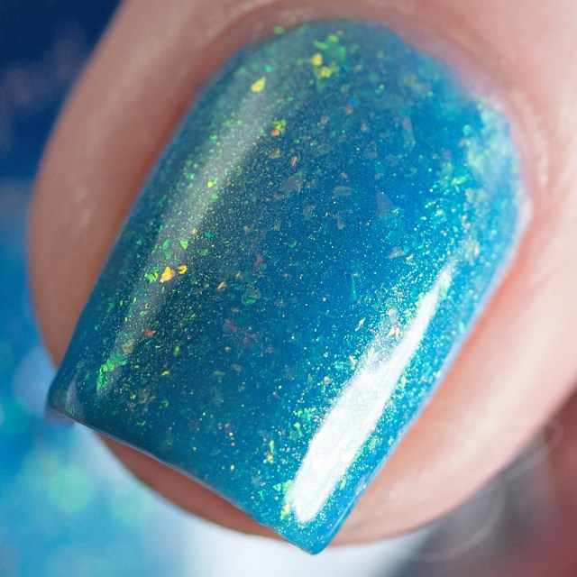 Pictured here is a nail polish created by Red Eyed Lacquer named I'm Real Happy To See You. This blue polish with flakies is inspired by Supernatural and a part of The Very Supernatural Collab