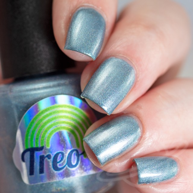 Pictured here is a nail polish by Treo Lacquer. This light blue holo polish is named Oh Yeah You Betcha and inspired by Supernatural. A part of The Very Supernatural Collab