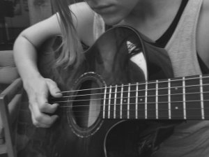 Shannon noodling around on the guitar
