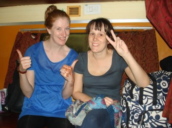 The girls getting ready to bed down for the night on the train
