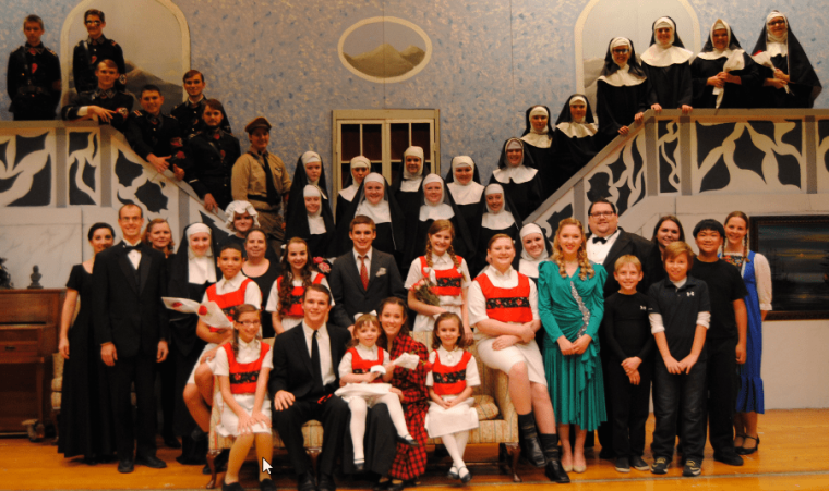 """The cast and crew of the hugely successful 2014 SHS musical, """"The Sound of Music"""" take a photo moment in the well-constructed """"living room of the Von Trapp Family Villa."""" (Phot credit: Dan Polinski)"""