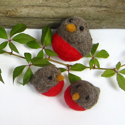 three needlefelt robins