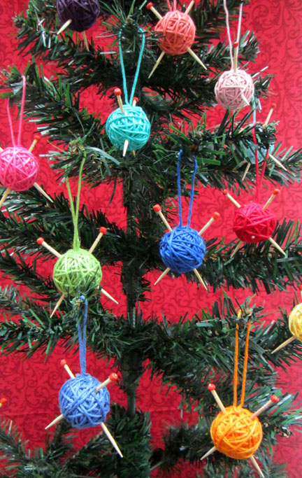 mini balls of yarn on tree for Advent Day 2