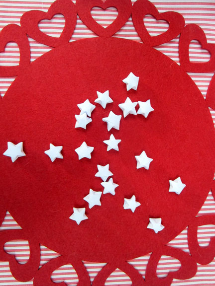 white origami stars on red