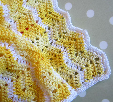 Ripple baby blanket in yellow and white